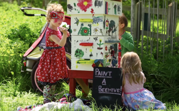 Children painting the community beehive